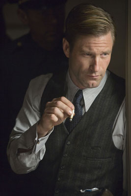 Aaron Eckhart smoking a cigarette (or weed)
