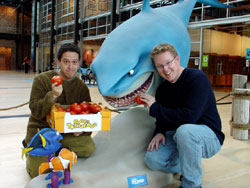 Rottentomatoes.com presented Finding Nemo directors Lee Unkrich (left) and Andrew Stanton (right) with the Fresh Pick of the Year Award as the best reviewed film of 2003 while Bruce the vegentarian Great White Shark looks hungrily at the box of fresh tomatoes.